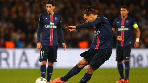 PARIS, FRANCE - FEBRUARY 16:  Zlatan Ibrahimovic of Paris Saint-Germain  scores their first goal from a free kick during the UEFA Champions League round of 16 first leg match between Paris Saint-Germain and Chelsea at Parc des Princes on February 16, 2016 in Paris, France.  (Photo by Christopher Lee - UEFA/UEFA via Getty Images)