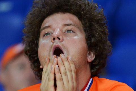 A Dutch fan stands dejected after during the Euro 2012 soccer championship Group B match between the Netherlands and Germany in Kharkiv, Ukraine, Wednesday, June 13, 2012. (AP Photo/Geert Vanden Wijngaert)