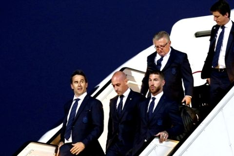 Spain's national soccer team arrives at Pashkovsky international airport in the town of Krasnodar, Russia, Thursday, June 7, 2018 to compete in the 2018 World Cup in Russia. The 21st World Cup begins on Thursday, June 14, 2018, when host Russia takes on Saudi Arabia. (AP Photo/Evgeny Reznik)