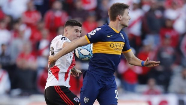 Boca Juniors' Franco Soldano, right, and River Plate's Gonzalo Montiel jump for a header during their Argentine first division soccer game in Buenos Aires, Argentina, Sunday, Sept. 1, 2019. (AP Photo/Natacha Pisarenko)
