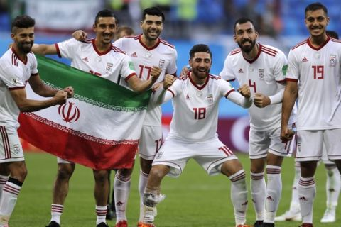 Iran's players celebrate their victory after the group B match between Morocco and Iran at the 2018 soccer World Cup in the St. Petersburg Stadium in St. Petersburg, Russia, Friday, June 15, 2018. (AP Photo/Themba Hadebe)