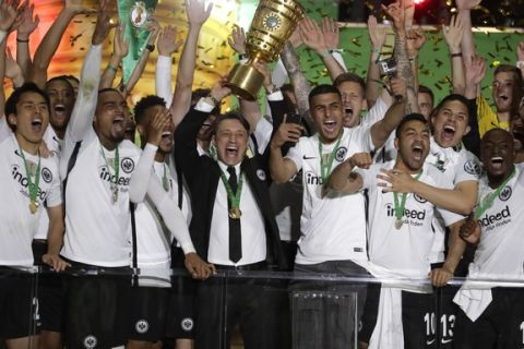 Eintracht coach Niko Kovac celebrates with the trophy after winning the German soccer cup final match between FC Bayern Munich and Eintracht Frankfurt in Berlin, Germany, Saturday, May 19, 2018. (AP Photo/Michael Sohn)