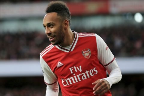 Arsenal's Pierre-Emerick Aubameyang during the English Premier League soccer match between Arsenal and Crystal Palace at the Emirates Stadium in London, England, in London, England, Sunday, Oct. 27, 2019. (AP Photo/Leila Coker)