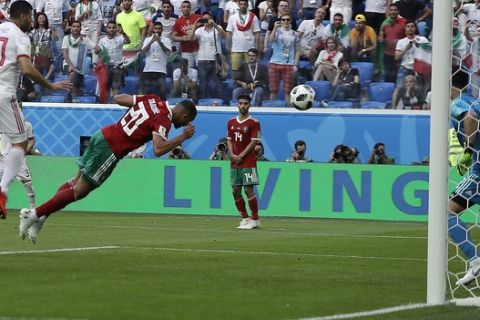 Morocco's Aziz Bouhaddouz, 20, scores own goal during the group B match between Morocco and Iran at the 2018 soccer World Cup in the St. Petersburg Stadium in St. Petersburg, Russia, Friday, June 15, 2018. (AP Photo/Themba Hadebe)