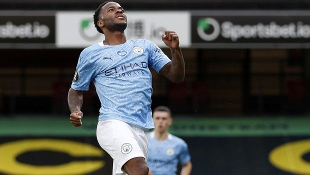 Manchester City's Raheem Sterling celebrates after scoring his side's opening goal during the English Premier League soccer match between Watford and Manchester City at the Vicarage Road Stadium in Watford, England, Tuesday, July 21, 2020. (Adrian Dennis/Pool via AP)