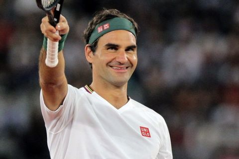 Roger Federer waves at the crowd during the exhibition tennis match against Rafael Nadal held at the Cape Town Stadium in Cape Town, South Africa, Friday Feb. 7, 2020. (AP Photo/Halden Krog)