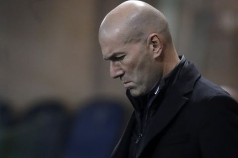 Real Madrid's head coach Zinedine Zidane walks on the touchline ahead the Champions League, round of 16, first leg soccer match between Atlanta and Real Madrid, at the Gewiss Stadium in Bergamo, Wednesday, Feb. 24, 2021. (AP Photo/Luca Bruno)