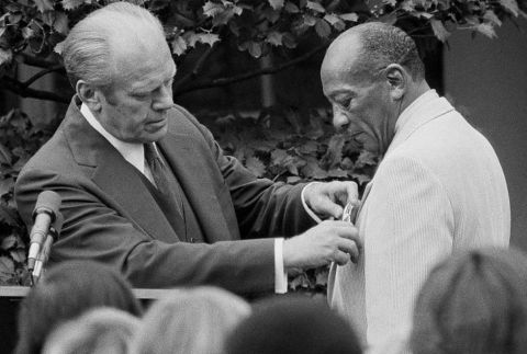 President Gerald Ford with Olympic gold medalist Jesse Owens after presenting him with the Medal of Freedom in a White House East Garden ceremony in Washington on August 5, 1976. Ford feted United States Olympic teams with a reception inside the Executive Mansion following the presentation. (AP Photo)