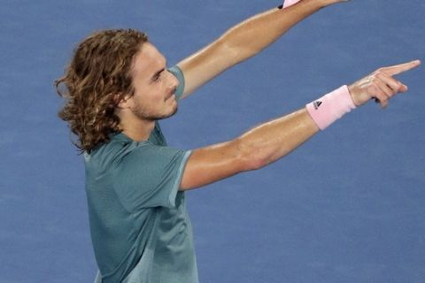 Greece's Stefanos Tsitsipas celebrates after defeating Switzerland's Roger Federer in their fourth round match at the Australian Open tennis championships in Melbourne, Australia, Sunday, Jan. 20, 2019. (AP Photo/Kin Cheung)