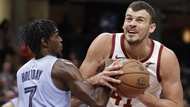Cleveland Cavaliers' Ante Zizic (41), from Croatia, drives to the basket against Memphis Grizzlies' Justin Holiday (7) in the first half of an NBA basketball game, Saturday, Feb. 23, 2019, in Cleveland. (AP Photo/Tony Dejak)