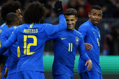 Brazil's Philippe Coutinho, 2nd right, celebrates after scoring his side's second goal during an international friendly soccer match between Russia and Brazil at the Luzhniki stadium in Moscow, Russia, Friday, March 23, 2018. (AP Photo/Alexander Zemlianichenko)