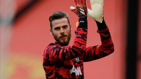 Manchester United's goalkeeper David de Gea warms up before the English Premier League soccer match between Manchester United and Fulham at Old Trafford stadium in Manchester, England, Tuesday, May 18, 2021. (AP Photo/Phil Noble, Pool)