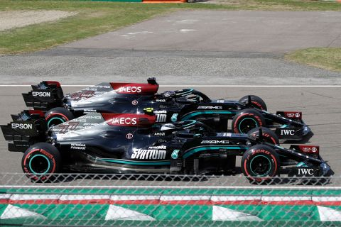 Mercedes driver Lewis Hamilton of Britain, top, and Mercedes driver Valtteri Bottas of Finland, steer their car during qualifying practice for Sunday's Emilia Romagna Formula One Grand Prix, at the Imola track, Italy, Saturday, April 17, 2021. (AP Photo/Luca Bruno)