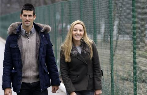 Serbia's tennis player Novak Djokovic and his girlfriend Jelena Ristic arrive for a visit to a school for mentally challenged children in Belgrade, Serbia, Wednesday, Feb. 6, 2013. Djokovic visited the school where the players charity fund donated euro 50,000 to be used for building a special playground. After winning the Australian Open last month, Djokovic says he is enjoying the off-season time with his family and friends in Serbia and will aim for the Roland Garros title this year _ the one Grand Slam tournament the World No-1 has not won so far. (AP Photo/Darko Vojinovic)