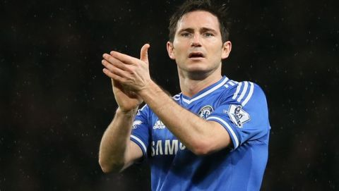 Chelsea's Frank Lampard applauds the fans at the end of the match in their English Premier League soccer match between Arsenal and Chelsea at the Emirates stadium in London, Monday, Dec. 23, 2013. (AP Photo/Alastair Grant)