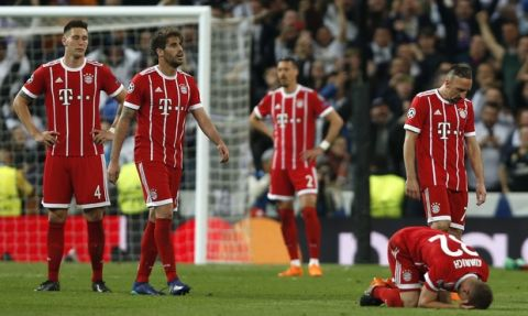 Bayern players react after the Champions League semifinal second leg soccer match between Real Madrid and FC Bayern Munich at the Santiago Bernabeu stadium in Madrid, Spain, Tuesday, May 1, 2018. (AP Photo/Francisco Seco)