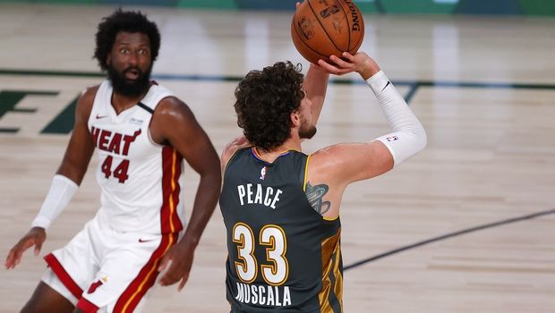 Oklahoma City Thunder's Mike Muscala (33) shoots the go-ahead 3-point basket next to Miami Heat's Solomon Hill during the fourth quarter of an NBA basketball game Wednesday, Aug. 12, 2020, in Lake Buena Vista, Fla. (Kevin C. Cox/Pool Photo via AP)