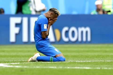Brazil's Neymar kneels on the pitch after scoring his side's second goal during the group E match between Brazil and Costa Rica at the 2018 soccer World Cup in the St. Petersburg Stadium in St. Petersburg, Russia, Friday, June 22, 2018. (AP Photo/Petr David Josek)