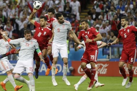 Iran's Morteza Pouraliganji, (8), handles the ball into the net, and the goal was dissallowd after a review by VAR during the group B match between Iran and Spain at the 2018 soccer World Cup in the Kazan Arena in Kazan, Russia, Wednesday, June 20, 2018. (AP Photo/Sergei Grits)