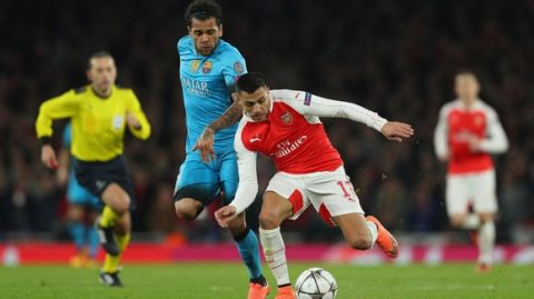 LONDON, ENGLAND - FEBRUARY 23:  Dani Alves of Barcelona makes a tackle on Alexis Sanchez of Arsenal during the UEFA Champions League round of 16 first leg match between Arsenal and Barcelona on February 23, 2016 in London, United Kingdom.  (Photo by Paul Gilham/Getty Images)
