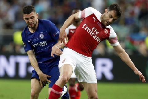 Chelsea's Mateo Kovacic fights for the ball with Arsenal's Sokratis Papastathopoulos, right, during the Europa League Final soccer match between Chelsea and Arsenal at the Olympic stadium in Baku, Azerbaijan, Wednesday, May 29, 2019. (AP Photo/Darko Bandic)