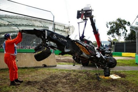 MELBOURNE, AUSTRALIA - MARCH 20: The wreck of Fernando Alonso of Spain and McLaren Honda is retrieved from the circuit during the Australian Formula One Grand Prix at Albert Park on March 20, 2016 in Melbourne, Australia.  (Photo by Robert Cianflone/Getty Images)
