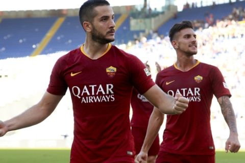 Roma's Kostas Manolas, left, and Lorenzo Pellegrini celebrate their side's 3-1 win at the end of the Serie A soccer match between Roma and Lazio, at the Rome Olympic Stadium, Saturday, Sept. 29, 2018. (AP Photo/Andrew Medichini)
