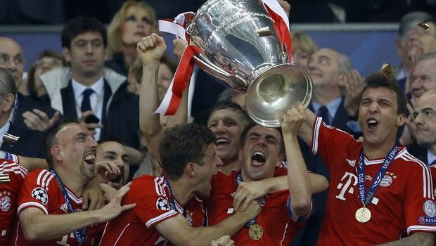 Bayern's Philipp Lahm holds up the trophy after his side won the Champions League Final soccer match against Borussia Dortmund, at Wembley Stadium in London, Saturday May 25, 2013.  (AP Photo/Kirsty Wigglesworth)