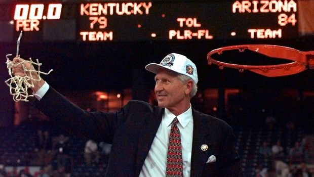 Arizona coach Lute Olson holds up the net for the fans after Arizona beat Kentucky 84-79 in overtime to win the national championship Monday, March 31, 1997,  at the NCAA Final Four tournament in Indianapolis.(AP Photo/Ed Reinke)