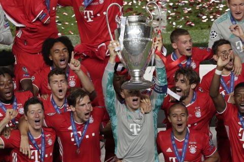 Bayern's goalkeeper Manuel Neuer lifts the trophy after the Champions League final soccer match between Paris Saint-Germain and Bayern Munich at the Luz stadium in Lisbon, Portugal, Sunday, Aug. 23, 2020. (AP Photo/Manu Fernandez, Pool)
