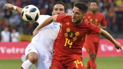 Portugal's Joao Moutinho, left, and Belgium's Dries Mertens battle for the ball during a friendly soccer match between Belgium and Portugal at the King Baudouin stadium in Brussels, Saturday, June 2, 2018. (AP Photo/Geert Vanden Wijngaert)