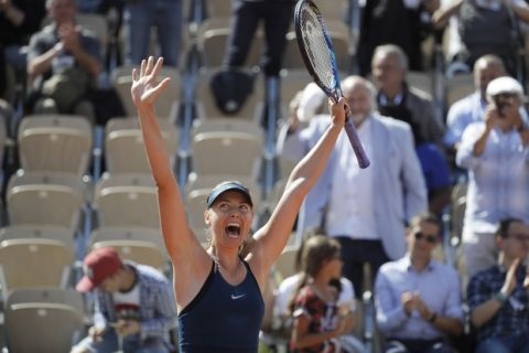 Russia's Maria Sharapova celebrates winning her first round match of the French Open tennis tournament against Netherland's Richel Hogenkamp at the Roland Garros stadium in Paris, France, Tuesday, May 29, 2018. (AP Photo/Alessandra Tarantino)