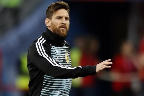 Argentina's Lionel Messi warms up prior to the start of the group D match between Argentina and Croatia at the 2018 soccer World Cup in Nizhny Novgorod Stadium in Novgorod, Russia, Thursday, June 21, 2018. (AP Photo/Pavel Golovkin)