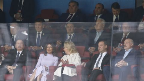 Azerbaijani President Ilham Aliyev, left, Russian Prime Minister Dmitry Medvedev, second from right, Belarusian President Alexander Lukashenko, right, sit behind the glass to watch the group A match between Russia and Saudi Arabia which opens the 2018 soccer World Cup at the Luzhniki stadium in Moscow, Russia, Thursday, June 14, 2018. (AP Photo/Hassan Ammar)