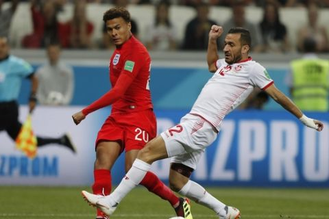 England's Dele Alli, left, and Tunisia's Ali Maaloul challenge for the ball during the group G match between Tunisia and England at the 2018 soccer World Cup in the Volgograd Arena in Volgograd, Russia, Monday, June 18, 2018. (AP Photo/Frank Augstein)