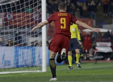 Roma's Edin Dzeko celebrates after scoring his side's opening goal after scoring his side's opening goalduring a Champions League round of 16 second-leg soccer match between Roma and Shakhtar Donetsk, at the Rome Olympic stadium, Tuesday, March 13, 2018. (AP Photo/Gregorio Borgia)