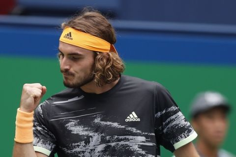 Stefanos Tsitsipas of Greece reacts as he plays against Felix Auger-Aliassime of Canada in the men's singles match at the Shanghai Masters tennis tournament at Qizhong Forest Sports City Tennis Center in Shanghai, China, Wednesday, Oct. 9, 2019. (AP Photo/Andy Wong)