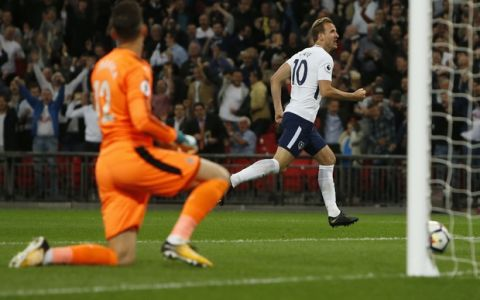 Tottenham Hotspur's Harry Kane, right, celebrates scoring his side's first goal passing Newcastle goalkeeper Martin Dubravka during the English Premier League soccer match between Tottenham Hotspur and Newcastle United at Wembley Stadium, in London, England, Wednesday, May 9, 2018. (AP Photo/Alastair Grant)