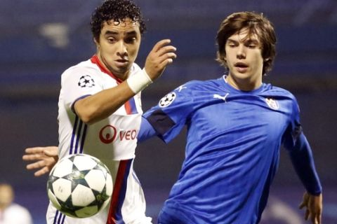 Lyon's Rafael, left, challenges for the ball with Zagreb's Ante Coric during the Champions League group H soccer match between Dinamo Zagreb and Olympique Lyonnais at Maksimir stadium in Zagreb, Croatia, Tuesday, Nov. 22, 2016. (AP Photo/Darko Bandic)