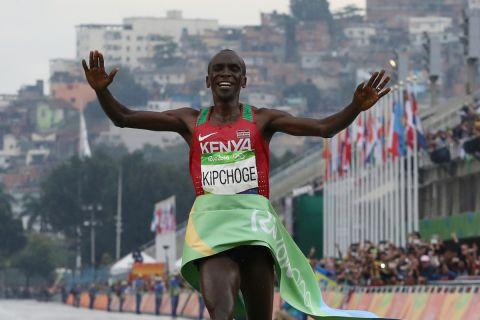 Kenya's Eliud Kipchoge crosses the finish line to win the men's marathon at the 2016 Summer Olympics in Rio de Janeiro, Brazil, Sunday, Aug. 21, 2016. (AP Photo/Petr David Josek)
