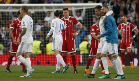 Real Madrid's Gareth Bale (11) and Bayern's Niklas Suele shake hands after the Champions League semifinal second leg soccer match between Real Madrid and FC Bayern Munich at the Santiago Bernabeu stadium in Madrid, Spain, Tuesday, May 1, 2018. (AP Photo/Francisco Seco)