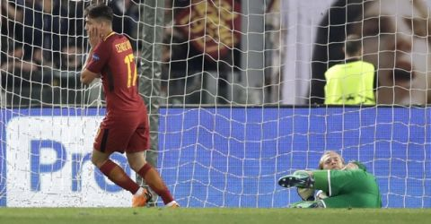 Roma's Cengiz Under reacts after Liverpool goalkeeper Loris Karius, on the ground, stopped his shot at goal during the Champions League semifinal second leg soccer match between Roma and Liverpool at the Olympic Stadium in Rome, Wednesday, May 2, 2018. (AP Photo/Alessandra Tarantino)