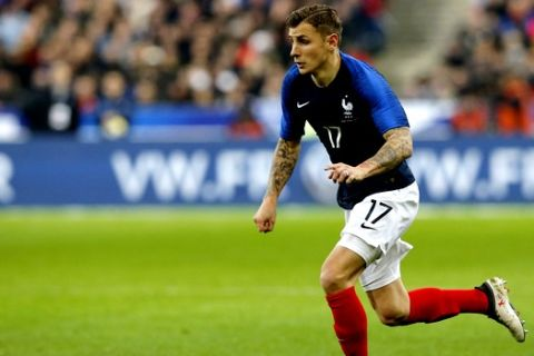 France's Lucas Digne controls the ball during a friendly soccer match between France and Colombia in Saint-Denis, outside Paris, Friday March 23, 2018. (AP Photo/Michel Euler)
