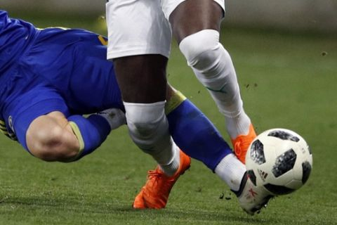 Senegal's Mbaye Niang, top, is tackled by Bosnia and Herzegovina Ognjen Vranjes during a friendly soccer match between Senegal and Bosnia and Herzegovina at the Oceane stadium in Le Havre, northern France, Tuesday, March 27, 2018. (AP Photo/Francois Mori)