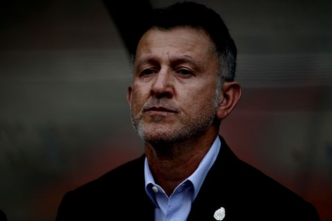 Mexico coach Juan Carlos Osorio stands at the bench before the start of a friendly soccer match against Scotland at Azteca Stadium in Mexico City, Saturday, June 2, 2018. (AP Photo/Eduardo Verdugo)