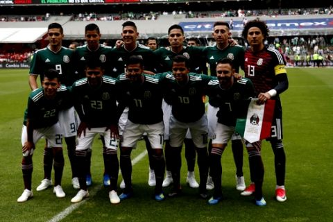 The Mexico national team poses for a group photo prior to a friendly soccer match against Scotland at Azteca Stadium in Mexico City, Saturday, June 2, 2018. (AP Photo/Eduardo Verdugo)