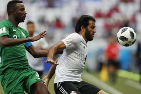 Saudi Arabia's Osama Hawsawi , left, and Egypt's Marwan Mohsen challenge for the ball during the group A match between Saudi Arabia and Egypt at the 2018 soccer World Cup at the Volgograd Arena in Volgograd, Russia, Monday, June 25, 2018. (AP Photo/Darko Vojinovic)