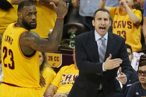 Cleveland Cavaliers head coach David Blatt yells at his team as LeBron James (23) looks on in overtime of Game 3 of the Eastern Conference finals of the NBA basketball playoffs against the Atlanta Hawks Sunday, May 24, 2015, in Cleveland. The Cavaliers won, 114-111, to take a 3-0 series lead. (AP Photo/Ron Schwane)