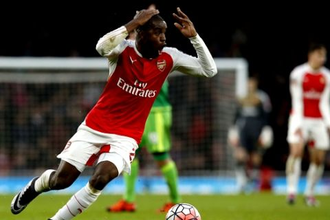 Arsenal's Joel Campbell reacts after giving away a foul during the English FA Cup third round soccer match between Arsenal and Sunderland at the Emirates stadium in London, Saturday, Jan. 9, 2016 . (AP Photo/Alastair Grant)