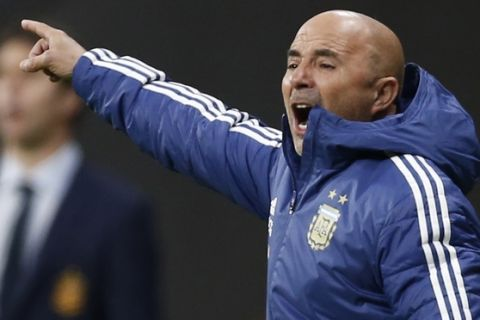 Argentina's coach Jorge Sampaoli gestures during the international friendly soccer match between Spain and Argentina at the Wanda Metropolitano stadium in Madrid, Spain, Tuesday, March 27, 2018. (AP Photo/Francisco Seco)